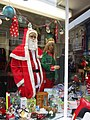 -2019-11-03 Santa and elf in a shop window, Church Street, Cromer.JPG
