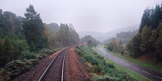 Highland Main Line - Highland Main Line and A9 highway next to each other in Perthshire, September 2000