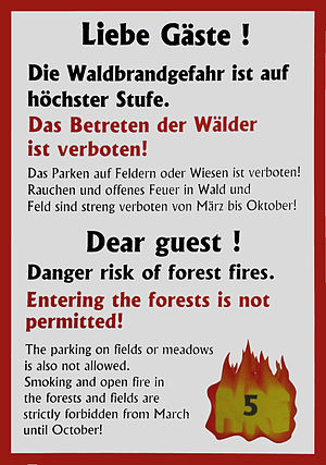 Fire protection - Public sign warning of the highest level of fire hazard at a campsite in Germany