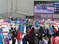 2014 WOG Biathlon Women Relay Flower Ceremony 02.JPG
