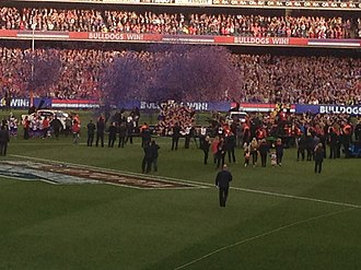 2016 AFL Grand Final - The Bulldogs team on the podium with the premiership cup