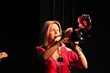 Young woman playing a flumpet – a hybrid of a trumpet and a flugelhorn