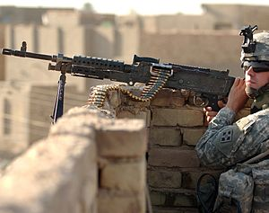 4th Infantry Division (United States) - A 4th Infantry Division soldier manning an M240 machine gun in Iraq.
