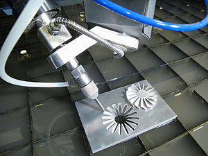 Multiaxis machining - A 5-axis water jet cutter and a part manufactured with it.