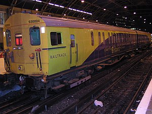 British Rail Class 930 - Class 930, no. 930004 at London Victoria on 18 March 2003, seen painted in Railtrack's blue and lime green livery.  This former 4-SUB unit was converted to a sandite/de-icing unit in 1979. It was withdrawn in mid-2004 and has since been scrapped.