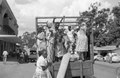 ASC Leiden - NSAG - van Es 2 - 003 - Women and men in traditional clothing with headscarves stand in the back of the open cargo space of a truck - Kampala, Uganda - 29-11-1961 - 4-12-1961.tiff