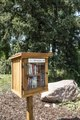 "A ""birdhouse library,"" one of several take-one, leave-one outreach boxes of the municipal library around Colorado Springs, Colorado LCCN2015634005.tif"