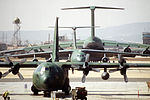 A C-130 Hercules, C-141B Starlifter and a C-5 Galaxy aircraft are parked on the Military Airlift Command flight line during Exercise Team Spirit '86 DF-ST-87-09684.jpg