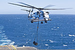 A U.S. Marine Corps CH-53E Super Stallion helicopter assigned to the 15th Marine Expeditionary Unit lifts a 500 gallon fuel blivet from the deck of the amphibious assault ship USS Peleliu (LHA 5) in the Pacific 120605-M-VZ265-809.jpg