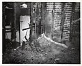 A shovel leans against the wall of a fire ravaged building (12306714043).jpg