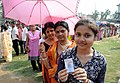 A young Girl showing her Voter ID Card, at a polling booth, during the 2nd phase of Assam Assembly Election, at Maidamgaon, Bakarapara, Basistha, in Kamrup district on April 11, 2016.jpg