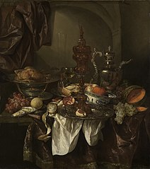Still life with fruit, roast, silver- and glassware, porcelain and columbine cup on a dark tablecloth with white serviette