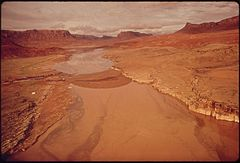 Aerial View Upstream of Boom Site in Monument Valley, Utah Where Oil Spill Into the San Juan River Was Contained before Flooding Caused Overflow of Oil and Debris Into Lake Powell, 10-1972 (3814970012).jpg