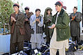 Afghan students applause after graduating the Trade Training School on Multinational Base Tarin Kot, Uruzgan province, Afghanistan, Oct. 13, 2011 111013-F-QS178-024.jpg