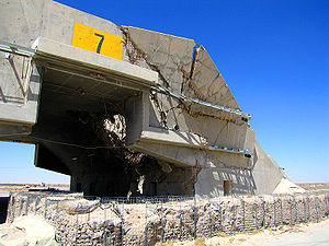 "Ali Al Salem Air Base - Significant bomb damage to a HAS incurred during the first Persian Gulf War in 1991. Bomb damage caused by precision guided ""bunker busting"" munitions was still visible 15 years after the liberation of Ali Al Salem."