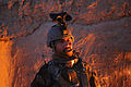 An Afghan National Army commando with the 3rd Company, 3rd Special Operations Kandak stands by a fire to stay warm in Bahlozi, Maiwand district, Kandahar province, Afghanistan, Jan. 1, 2014 140101-A-LW390-118.jpg