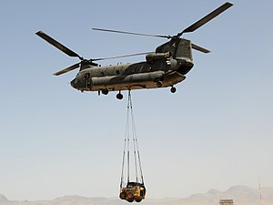 An Australian army CH-47 Chinook Helicopter lifts a front loader off the flight line at Special Operations Task Force-Southeast's Forward Operating Base Camp Ripley, Tarin Kowt.jpg