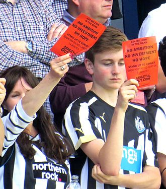 """Mike Ashley (businessman) - Newcastle fans show """"Mike Ashley Out"""" cards away to QPR in May 2015"""