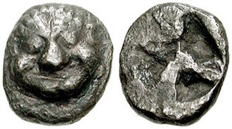Obol (coin) - Silver Obol of Athens, dated 515-510 BC. Obv. Gorgoneion Rev. Incuse square.