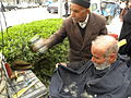 Barber on the sidewalk of a street in Nishapur 5.JPG