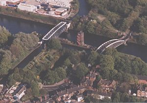 Barton-upon-Irwell - The SW portion of Barton showing the Bridgewater Aqueduct (left) and the road swing-bridge (right) crossing the Ship Canal, with adjacent housing