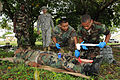 Belize Defence Force combat medics, Cpl. Paul Shal and Lance Cpl. Leon Lopez, right, provide medical attention to a field casualty, role player, while being observed by Belize Defence Force and U.S. Army 100830-A-CL600-043.jpg