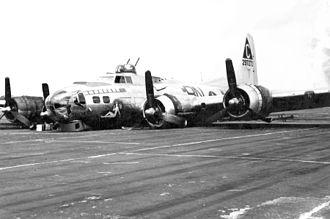 Belly landing - A Boeing B-17, Dutchess' Daughter, after a belly landing. (July 6, 1944)