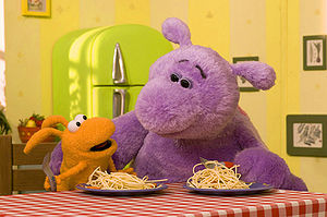 A publicity still showing the characters Big (right) and Small from the CBBC preschool comedy Big & Small. Both characters are represented by puppets, and are voiced by Lenny Henry.