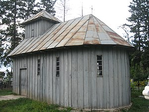 Batten - Board and batten siding on a chapel named the Wooden Church (Biserica de lemn) in Zvoriștea, Romania
