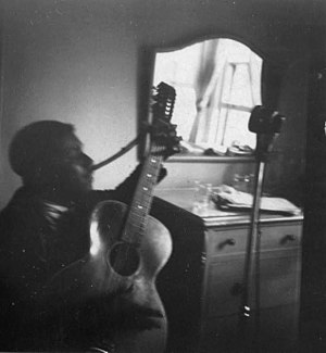 Blind Willie McTell - McTell recording for John Lomax in an Atlanta hotel room, November 1940 (photograph by Ruby Lomax)