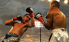 Ricardo Dominguez (left) is throwing an uppercut on Rafael Ortiz (right).