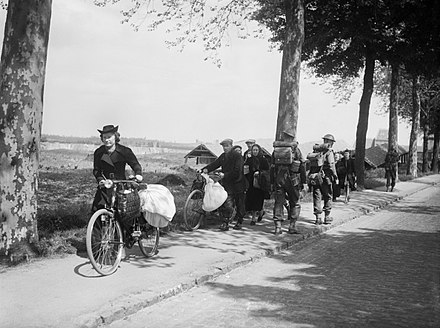 Belgian civilians fleeing westwards away from the advancing German army, 12 May 1940 British troops and Belgian refugees on the Brussels-Louvain road, 12 May 1940. F4422.jpg