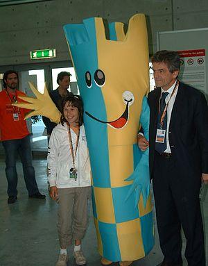 37th Chess Olympiad - Italy's Marina Brunello (12), with Olympiad mascot Ruki and Turin Mayor Sergio Chiamparino