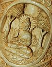 Buddha in meditation Roundel 25 buddha ivory tusk.jpg