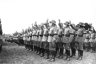 Hitler oath - Reichswehr soldiers swear the Hitler oath in 1934, with hands raised in the traditional schwurhand gesture