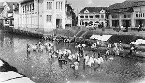 North Jakarta - Laundry workers working at Ciliwung river in Pasar Baru, circa between 1915 and 1925.