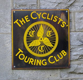 Cycling UK - CTC plaque on the wall of a guest house in Ingleton, North Yorkshire