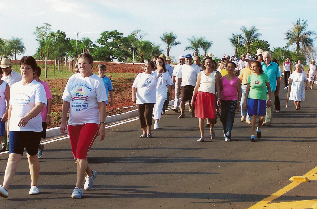A community with aging members joins together for a group walk.