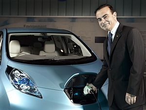 Nissan CEO Carlos Ghosn charges a Nissan Leaf,...