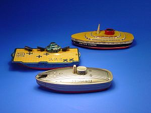 Tin toy -  Aircraft carrier, cruise ship, and submarine made of tin