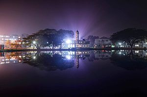 Sher-e-Bangla Medical College - Night view of the Central Mosque of SBMC on the bank of the pond