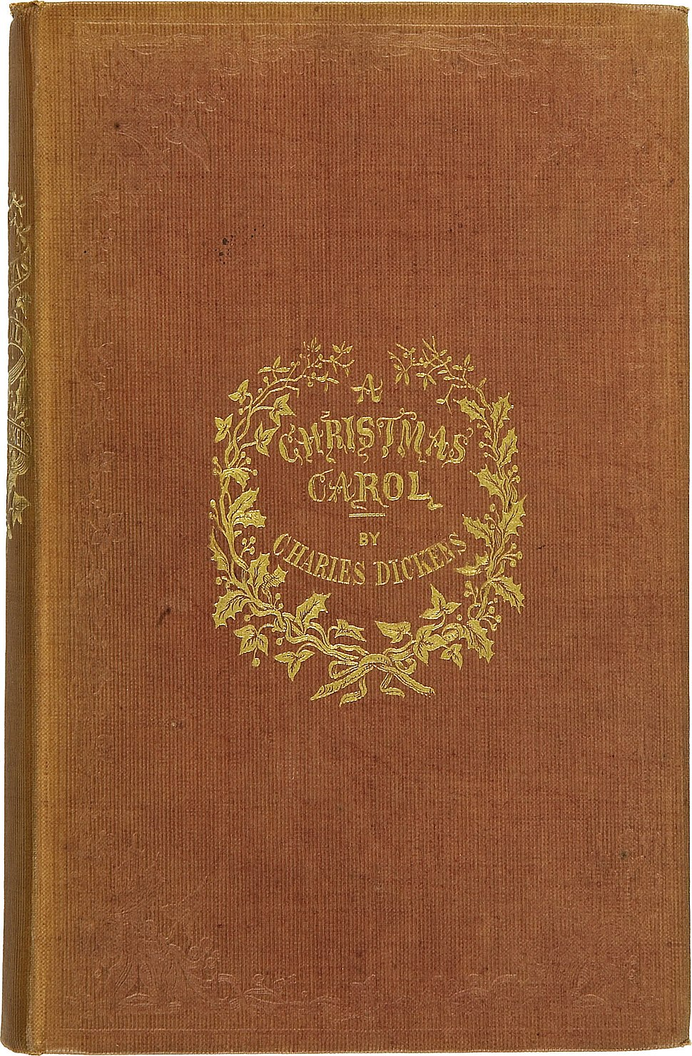 """Brown book cover bearing the words """"A Christmas Carol by Charles Dickens"""" in gold."""