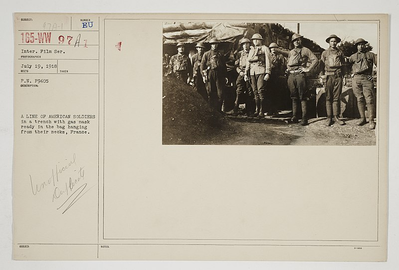 File:Chemical Warfare Service - Equipment - Miscellaneous - A line of American soldiers in a trench with gas mask ready in the bag hanging from their necks, France - NARA - 26424050.jpg