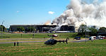 Civilian emergency equipment and helicopters gather at the Helicopter Landing Pad side of the Pentagon where a suspected terrorist crash of a commercial airliner into the building 010911-F-XT317-010.jpg