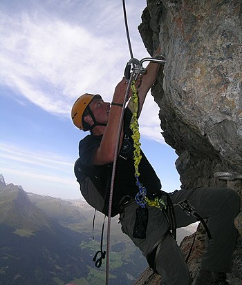 English: Climber on fixed rope route Piz Mitge...