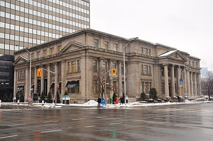 The Lillian Massey Building's longer facade in this photo is located along Queen's Park; the shorter facade fronts onto Bloor Street.