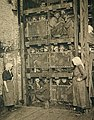 Coal Miners coming up a Coal Mine Elevator after a day of work.jpg