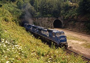Gallitzin Tunnel - Conrail 6169 leads a westbound train through the west portal of the Gallitzin Tunnel in 1993. At right, the west portal of the Allegheny Tunnel.