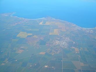 Copper Coast - Aerial view of the Copper Triangle, looking roughly west, toward Spencer Gulf. Kadina is in the center (inland), Wallaroo and Moonta on the coast (right and left, respectively)
