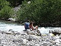 Couple Resting by River - Theth Village - Northern Albania (40927950240).jpg